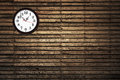 Clock hanging on a wooden wall Stock Photo