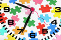 Clock and Jigsaw Puzzle Stock Image