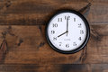 Clock on old wood Royalty Free Stock Photo