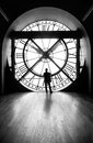 Clock with a silhouette of a man, b&w image Royalty Free Stock Photo