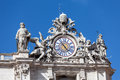 Clock on the top of st piter s basilica architectural detail with in vatican city rome italy Royalty Free Stock Images