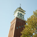 Clock tower against blue sky with weather vane on top Stock Photography