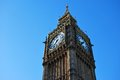 Clock tower of big ben the elizabeth or against blue sky in bright sunshine Stock Photo