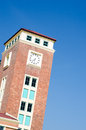 Clock tower in the blue sky Royalty Free Stock Image