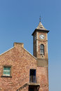 Clock tower with blue sky at kingsand cornwall england united kingdom Royalty Free Stock Photos