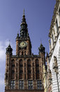 Clock tower and buildings on long market street in the old town of gdansk Stock Photos