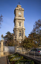 Clock tower from dolmabahce palace istanbul is a situated outside in turkey the was ordered by ottoman Royalty Free Stock Images
