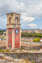 Clock tower at old venetian fortress with old city at background Royalty Free Stock Photo