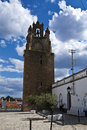 The clock tower of serpa portugal highest point in town is remodeled in to lodge town's great which still Royalty Free Stock Photos