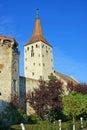 Clock tower and wall of ancient citadel Royalty Free Stock Photo