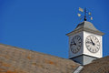 Clock tower with weather vane on top of a building in gloucester united kingdom Royalty Free Stock Photos