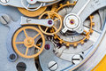 Clock transmission macro view. Stopwatch chronometer mechanism cogs gears wheels connection concept. Shallow depth of