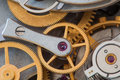 Clock transmission macro view. Stopwatch chronometer mechanism cogs gears wheels connection concept. Shallow depth of Royalty Free Stock Photo