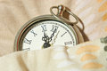 Clock under the covers Royalty Free Stock Photography
