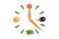 Clock of vegetables with arrows of the carrots isolated on white background Stock Photography