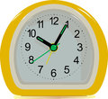 Clock yellow alarm on a white background Royalty Free Stock Photos