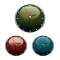 Clocks three simple with different colors in white background Royalty Free Stock Photos