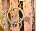 Clockwork antique clock s gears on the wooden detail Stock Image