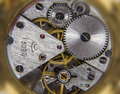 Clockwork background close macro of cogs Royalty Free Stock Photo