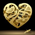 Clockwork heart raster version of vector image of gold on the black background with a pinion contain the clipping path there is in Stock Images