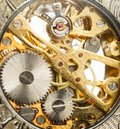 Clockwork inside mechanism in closeup Stock Images