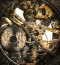 Clockwork inside mechanism in closeup Royalty Free Stock Photos