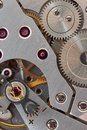 Clockwork macro mechanic with gears ruby and spring time concept Stock Photos