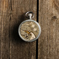Clockwork mechanism over wooden background Stock Photos