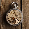 Clockwork mechanism over wooden background Stock Photography