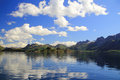 Clods mirrors in the fjord mountains mirroring near trollfjord arctic norway Stock Images