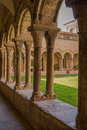Cloister arcades the ancient of the belonging to the monastery of les avellanes near the city of balaguer in eastern spain Royalty Free Stock Photo