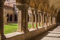 Cloister arcades the ancient of the belonging to the monastery of les avellanes near the city of balaguer in eastern spain Stock Photos