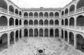 Cloister and colonnades of the university of valladolid wide angle view four sided inner colegio de santa cruz first building Royalty Free Stock Photo
