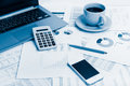 Close of business workplace with financial reports and office st Royalty Free Stock Photo