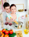 Close couple preparing spaghetti and drinking wine Royalty Free Stock Images