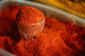 Close Glass With Powdered Paprika, Cayenne Pepper. Heap Of Bright Red Fragrant Spice Royalty Free Stock Photo