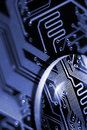 Close inspection abstract composition with glass lens on printed circuit board Royalty Free Stock Photography