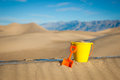 Close plastic bucket shovel shot of and yellow in scene of sand Royalty Free Stock Photos