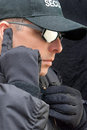 Close protection listens to earpiece up of a officer listening his Royalty Free Stock Images