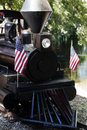 Close shot of miniture rail road engine with us flags Stock Photo