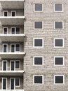 Close up of abandoned apartments building under construction abstract block flats detail brick wall with windows as pattern Royalty Free Stock Photo