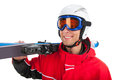 Close up of active smiling skier in mask looking away standing with ski isolated over white background Royalty Free Stock Photography