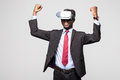 Close up of African employee wearing formal suit and goggles, experiencing virtual reality, stretching his arms up like win game.