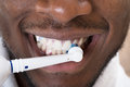 Close-up Of An African Man Cleaning His Teeth Royalty Free Stock Photo