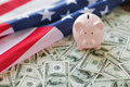 Close up of american flag, piggy bank and money Royalty Free Stock Photo