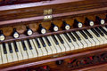Close-up of antique reed organ harmonium Royalty Free Stock Photo