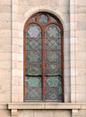 Close up of arched green detailed stained glass church window in Cradock Royalty Free Stock Photo