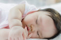Close up asian baby girl sleeping Royalty Free Stock Photo