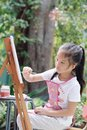 Close up of Asian child girl is painting on the canvas. Royalty Free Stock Photo