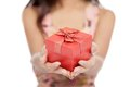 Close up of asian woman give red gift box focus on the gift isolated white background Stock Photography